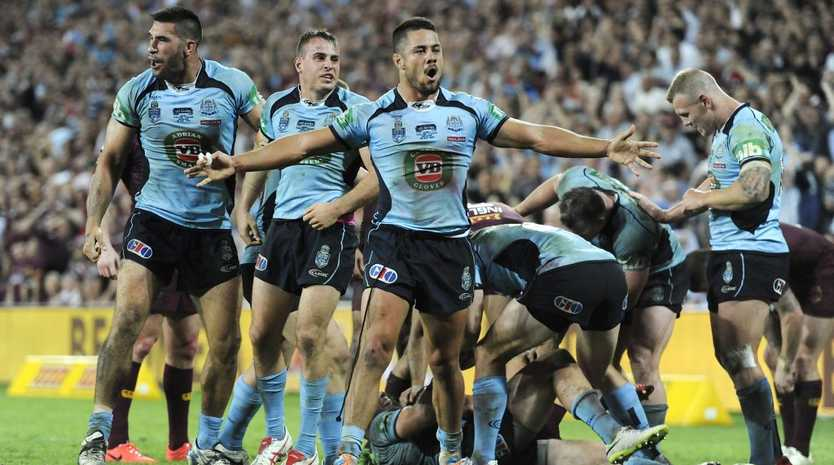 NSW Blues player Jarryd Hayne (centre) celebrates defeating Queensland in Game one of the 2014 State of Origin rugby league series at Suncorp Stadium in Brisbane.