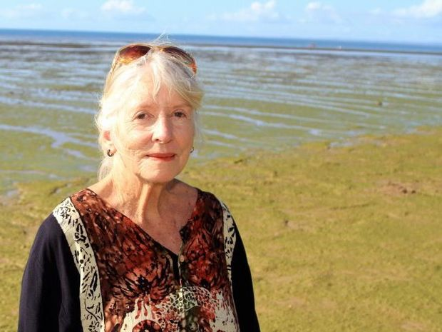 Jill Cameron says the algae has little impact on her enjoying the beach because she can still swim and there is no smell to deter her.