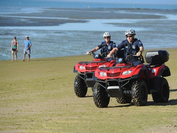 Constable Belinda Nevell and Constable Dylan Rippon on patrol on Scarness beach on quad bikes.
