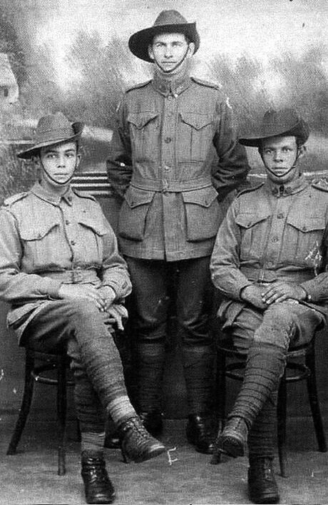 FAMILY MYSTERY: Private Archie McDonald (centre), of Wyrallah, with brothers Ronald (left) and Duncan.
