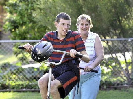 Jeff Achay and his Mum Cathy, with his bike that was specially made for someone with a disability.