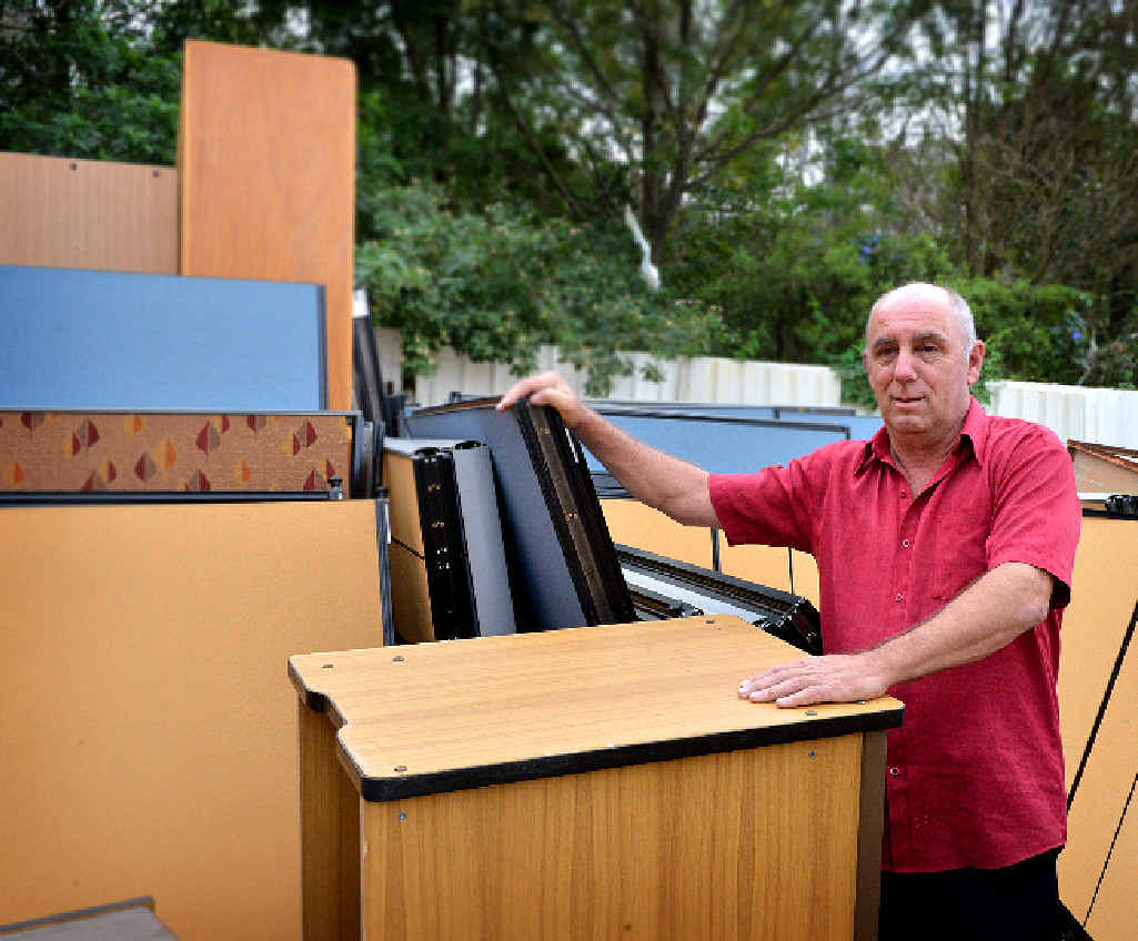 Gympie Loans and Trading owner Rob Pike checks out the bargains at the Gympie dump.