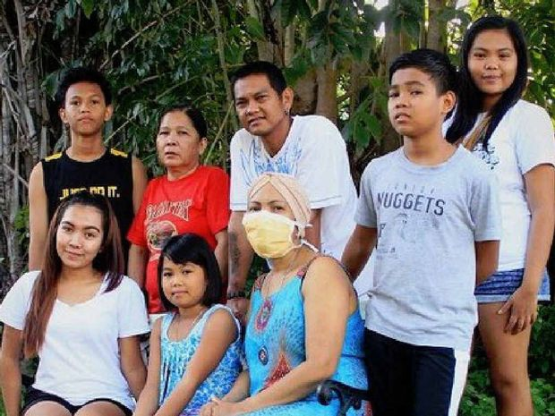 BRAVE: The Alquinto family before Analiza (front right) flew back to the Philippines in February.