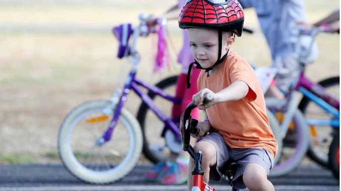 BUCKLE UP: Local children hit the bitumen for a bicycle safety workshop.