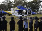 RACQ helicopter lands at Middle Ridge School as part of road safety initiative.