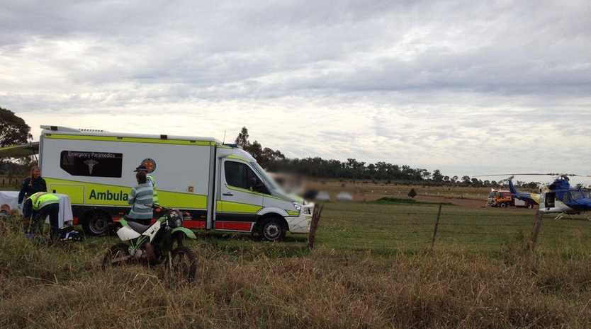 A DIRT bike rider was flown to hospital after crashing into a barbed wire fence on Kingsthorpe Haden Rd property at Boodua.