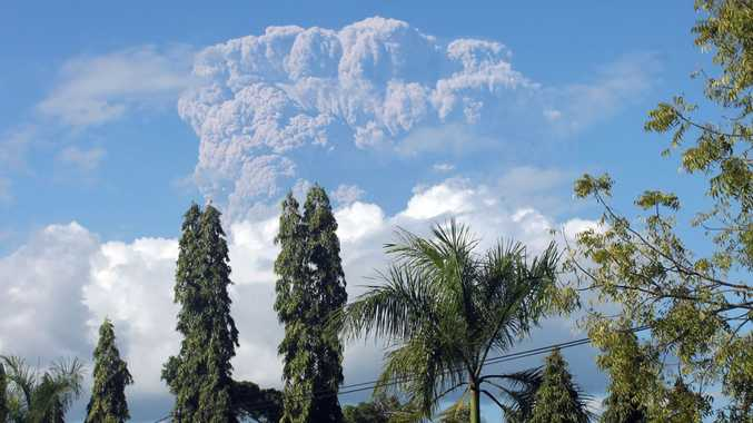 Mount Sangeang Api spews volcanic materials, seen seen from the town of Bima, West Nusa Tenggara province, Indonesia, 30 May 2014. The volcano erupted on 30 May with a loud blast and spewed volcanic ash about 3,000 meters high, Sutopo Nugroho, spokesman for the National Disaster Management Agency said.