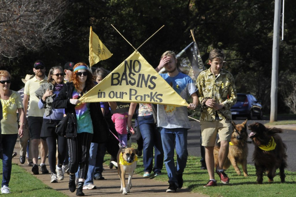 Protestors march to World Environment Day activities at Lake Annand, continuing their opposition to the detention basins.