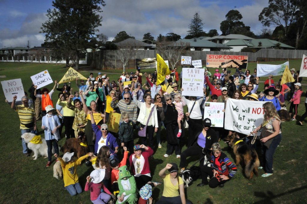 Protestors march to World Environment Day activities at Lake Annand, continuing their opposition to detention basins planned for Garnet Lehmann Park and Ballin Park.