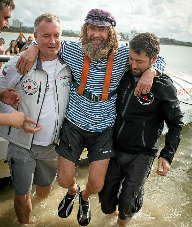 SEA LEGS: Mr Konyukhov is helped ashore at the Mooloolaba Spit, his first time on land since December.