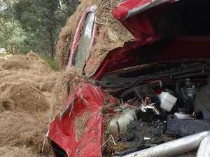 Hay crushes ute in road accident