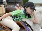 TAKING A BREAK: Emily Turner relaxes on pony Diamond between events.