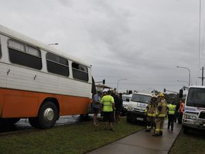 Two taken to hospital after crash between bus and cars