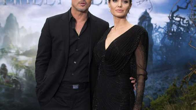 Angelina Jolie and Brad Pitt attend a private reception as costumes and props from Disney's 'Maleficent' are exhibited in support of Great Ormond Street Hospital at Kensington Palace.