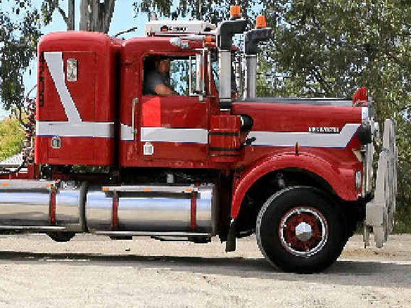 BEEP BEEP: Warren Smith drives his Kenworth into the Heritage Truck Show.