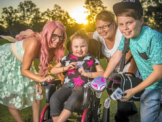 DIG DEEP: To help Shontae Denniss, 6, her mother Michelle and her brother Blake, 12, buy a car with wheel chair access, a family fun day will be held at Boyne Tannum Golf Club, with the help of Alana McMullen, also known as Pink Tink.