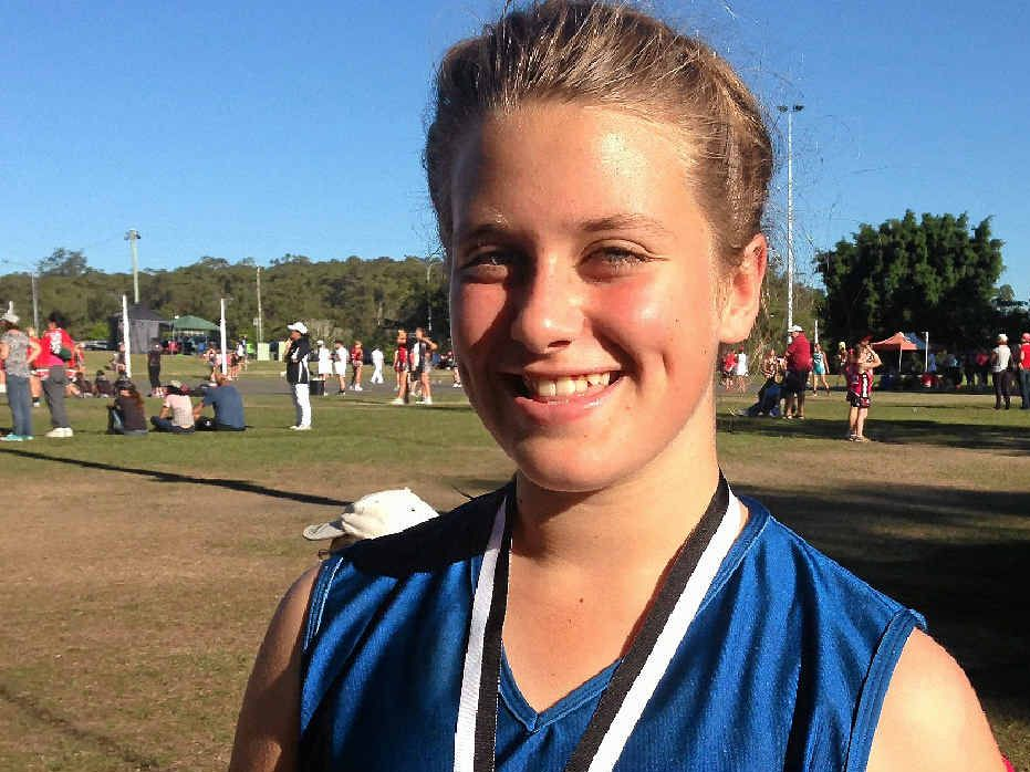 Darling Downs 12-years netball player Lucy Mantova with her runner-up medallion after the Underwood Park representative netball carnival in Brisbane last weekend.