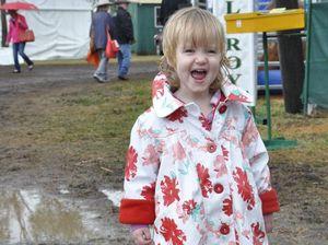 Heavy rain turns FarmFest into sea of mud, coats and boots