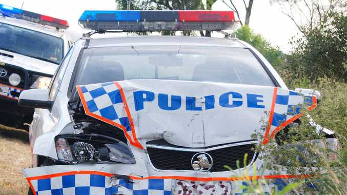 WRITE-OFF: The police car rammed east of Comet by a driver who is still on the run.