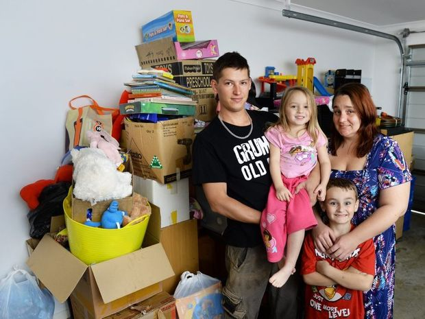 DOUBLE TROUBLE: Fire victims James Lucacevich and Michelle Stewart with children Levi, 6, and Amelia, 3, are again without a car following a crash at Goodna on Tuesday.