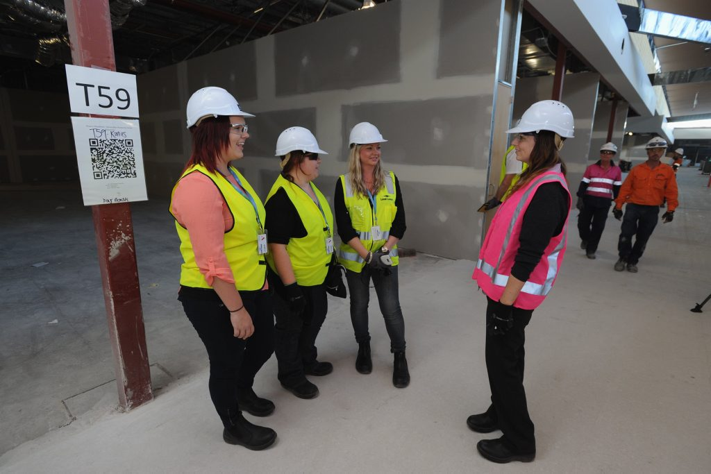 Stockland Shopping Centre - (L) Emily Waterson, Michele Moran and Fran Cammelot from Angus and Coote tour the new building with Stockland marketing manager Melissa Bampton.