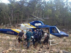 Woman airlifted to hospital following 50 metre fall.