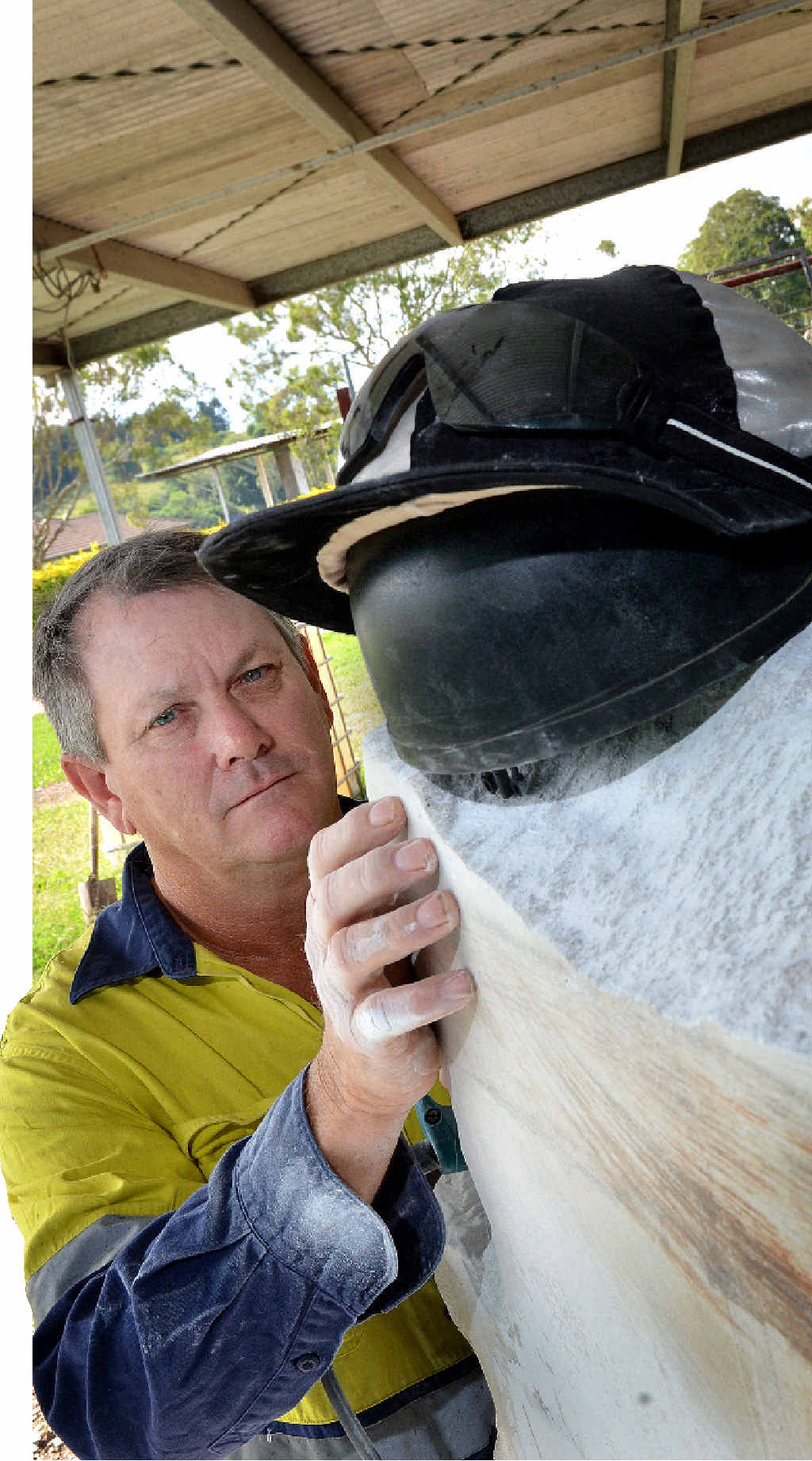 THE WORK BEGINS: Dan Davies cuts into the marble block which will become a memorial to Gympie jockey Desiree Gill.