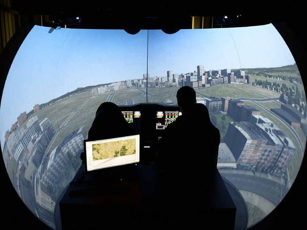 TAKING OFF: Christopher du Plessis from Geosim, an Ipswich-based company making flight simulators for defence and commercial training.
