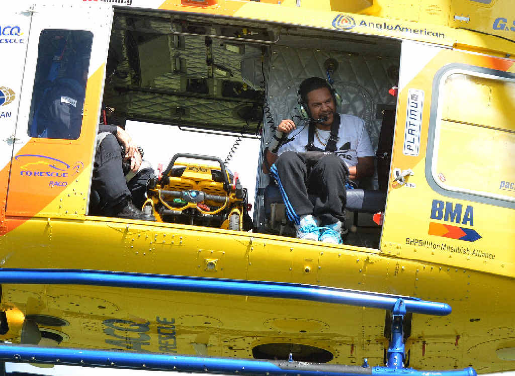 SPECIAL FLIGHT: Shannon Yasserie, with RACQ-CQ Rescue crewman Russell James, waves to supporters on the ground as he takes off for a helicopter flight and ticks an entry on his bucket list.