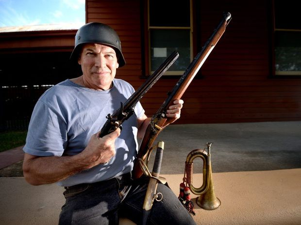 Don Mahoney with some of the historical weapons up for auction on the weekend. Photo Allan Reinikka / The Morning Bulletin