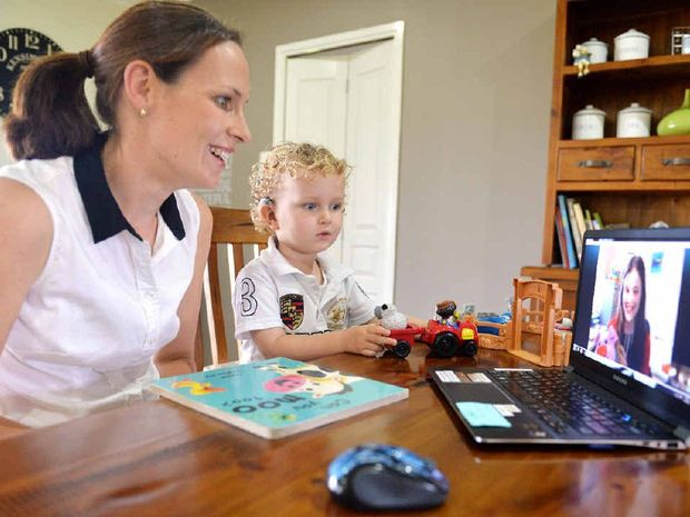 HEAR AND SAY: Sally and Fletcher Tudor go online at home with his speech therapist Elise. The program is proving very effective to stimulate his audio and verbal development.