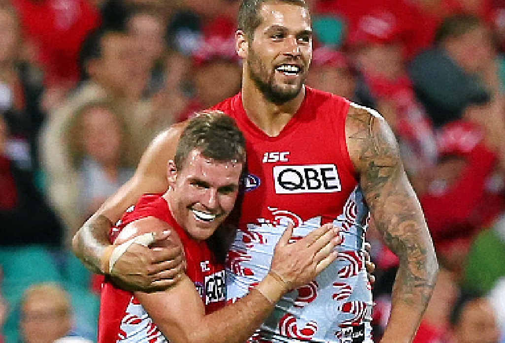 TOGETHER AGAIN: The Swans' Ben McGlynn and Lance Franklin celebrate a goal against Geelong at the SCG last week.