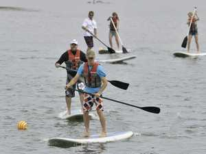 The 2014 RE/MAX Baffle Creek Raft Race was held at the Flat Rock Boat Ramp on June 8. Andy Dent leading the open sprint stand-up paddle board race, followed closely by Luke Grice.