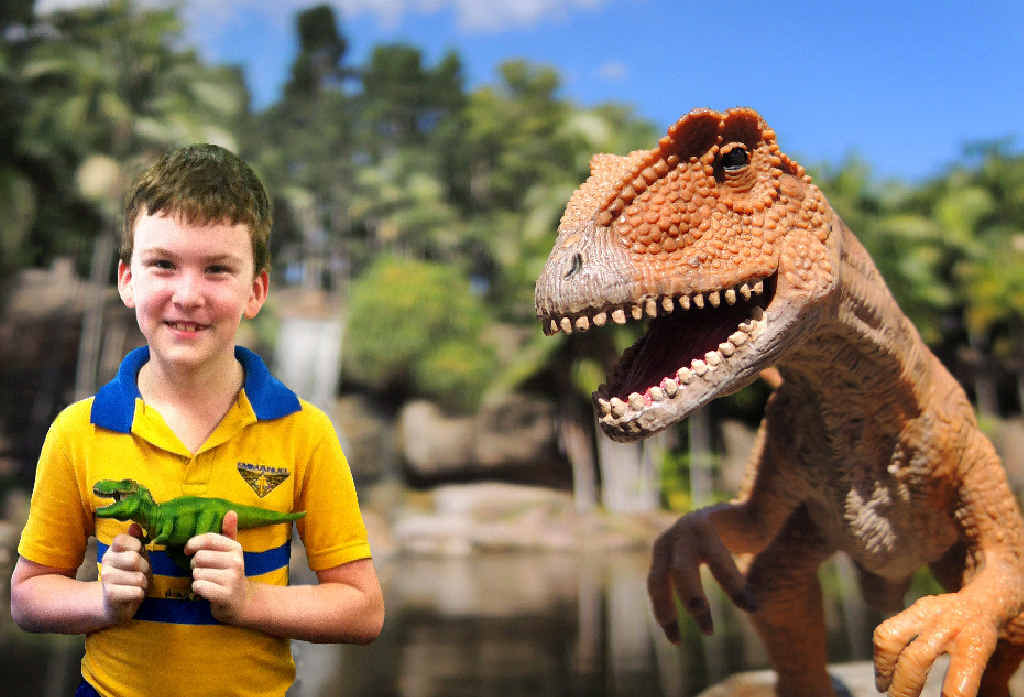 SUPER EXCITED: Alex Howarth, 8, loves everything about dinosaurs.