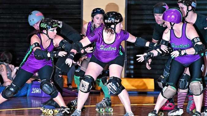 IN ACTION: Hustlers' Voodoo Vixen, KK Ruff N Stuff and Zerky provide strong defence.