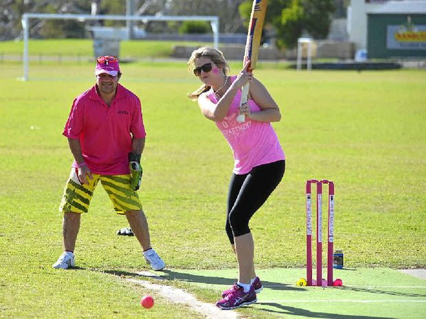 FIRST WICKET: Taylah Brackin hits out, with Gavin Beckhouse as wicketkeeper, at the Pink Stumps Day event at Queens Park.