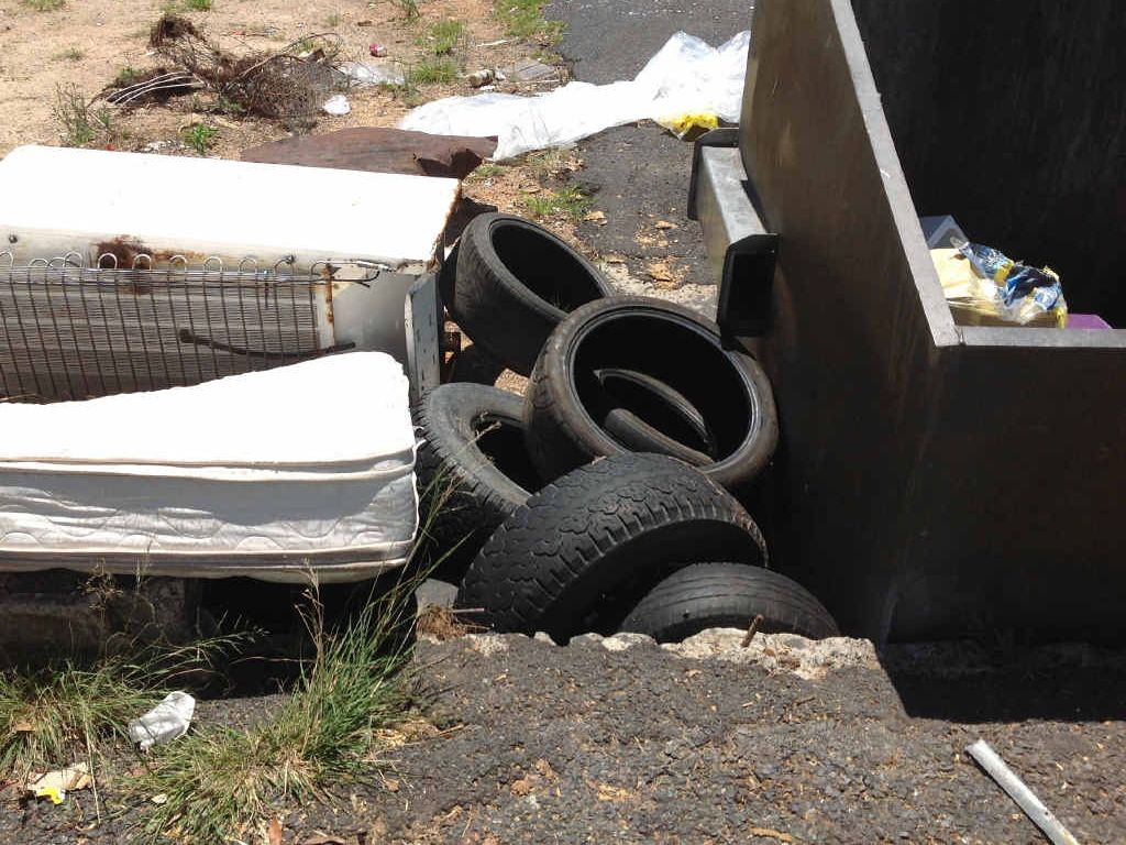 NAUGHTY: Tyres and bulky items dumped illegally at one of the region's bin enclosures.