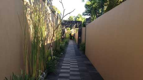 TROPICAL WALKWAY: One of the many tropical-lined walkways at the Mutiara.