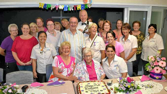 BIG BIRTHDAY: Miriam 'Topsy' Stevens with her son John (behind), daughter-in-law Jannie (left) and the staff from St Michael's Aged Care.