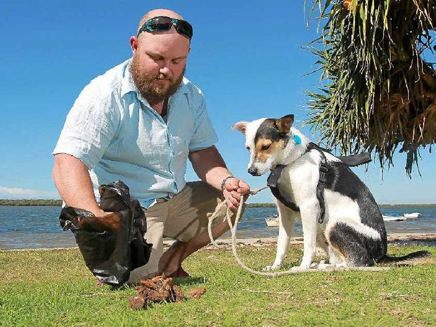 Ardin Timms, walking his dog, Finn, at Golden Beach near Military Jetty, is concerned a reduction in dog tidy bags has led to an increase in left droppings around the area.