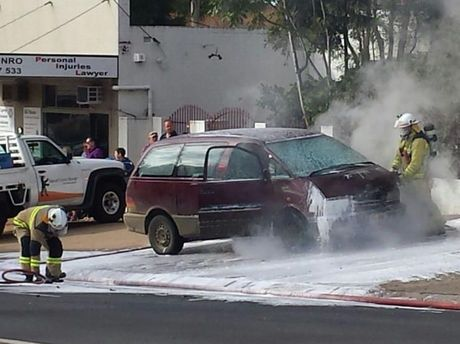 Emergency services extinguish a car on fire at the intersection of Herries and Kitchener Sts.