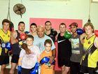Coach Dan Saumaki with members of Dan's Amateur Boxing and Fitness Club.