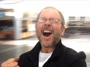 Man films hilarious music video while stranded at airport