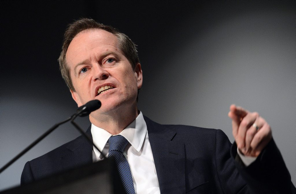 Opposition leader Bill Shorten looks on during an address to the Australian Council of Social Services (ACOSS) National Conference in Brisbane today. (AAP Image/Dave Hunt)