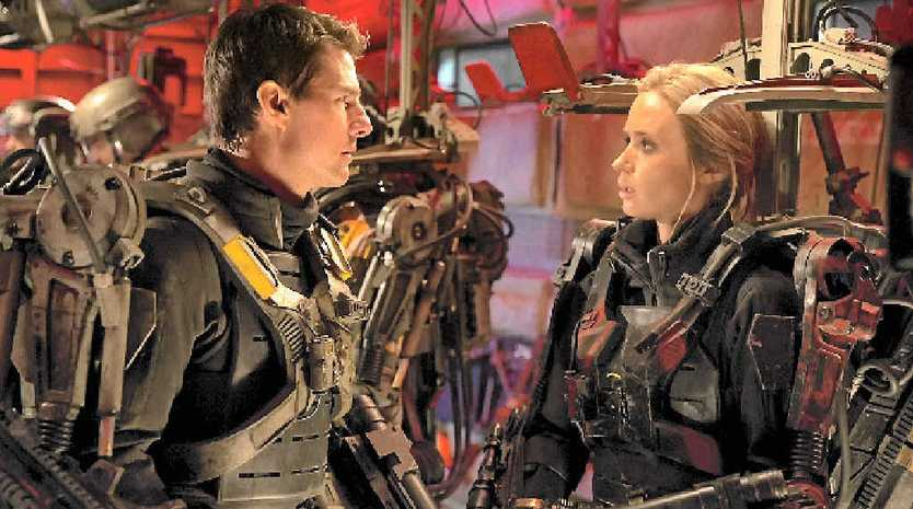 AT THE MOVIES: Tom Cruise and Emily Blunt in a scene from the movie Edge of Tomorrow. Supplied by Warner Bros.