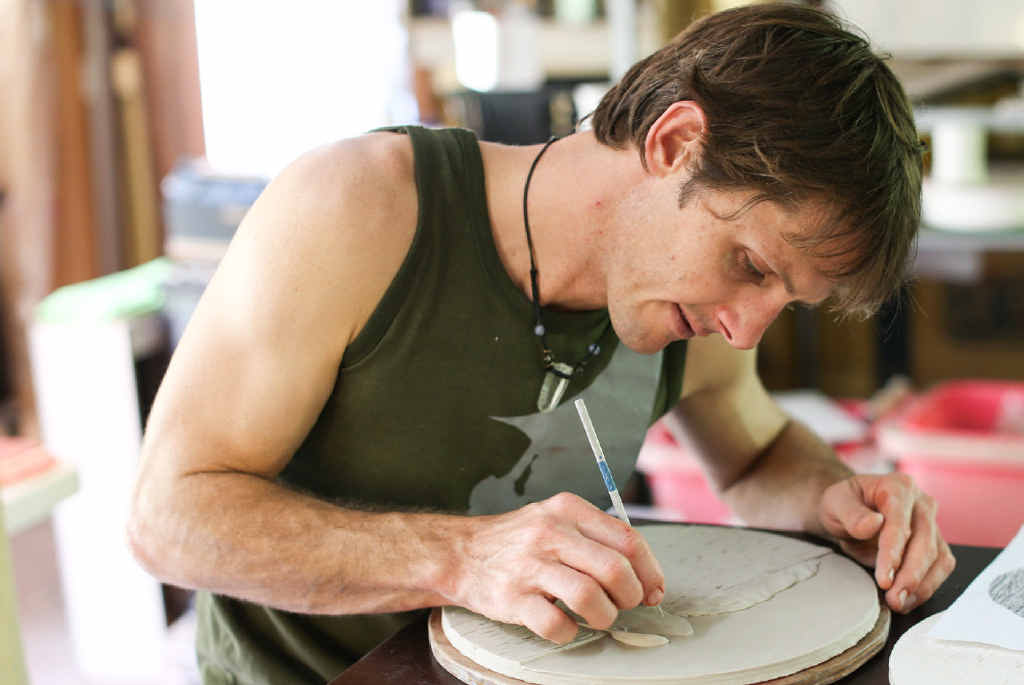 HANDS ON: Ceramic artist Renton Bishopric at work on the Through the Porthole project.
