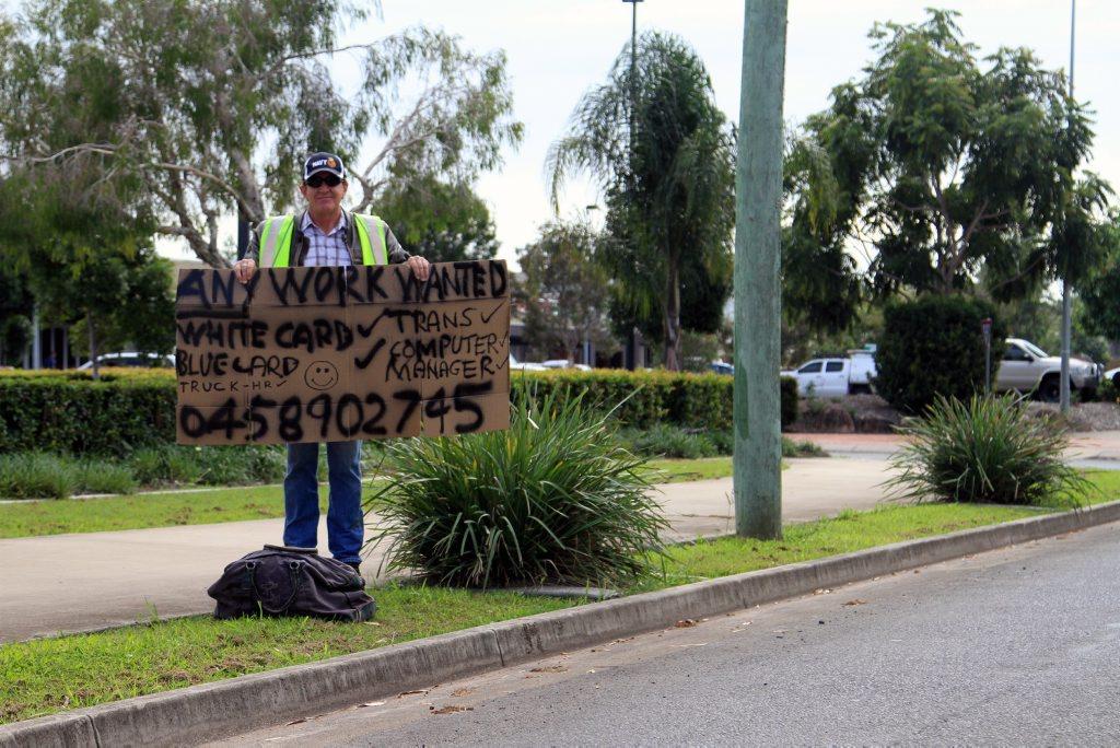 Hervey Bay man Graham Smyth, 54, standing roadside to attract a job offer.