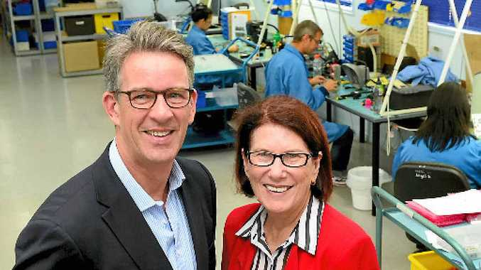 SOARING HIGH: Chamber of Commerce and Industry Queensland CEO Stephen Tait congratulates Microair business manager Jeanette Nock as the company becomes a global force in the avionics industry.