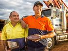 TRUCK BUDDIES: David and Rhys Nelson with their awards and Rhys's truck that won the Best Bush Log Truck award on the weekend. David won the same award 20 years ago. Photo: Adam Hourigan
