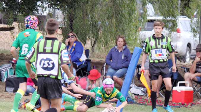 HE'S OVER: A Central West under-13s player scores a try in the match against Central Highlands.